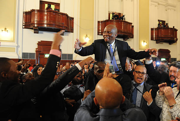 JOHANNESBURG, SOUTH AFRICA  AUGUST 22: (SOUTH AFRICA OUT): The newly elected City of Johannesburg Mayor Herman Mashaba celebrates with DA members during an inaugural council meeting on August 22, 2016 in Johannesburg, South Africa. Mashaba received 144 votes, while ANCs Parks Tau received 125 votes. (Photo by Felix Dlangamandla/Foto24/Gallo Images/Getty Images)
