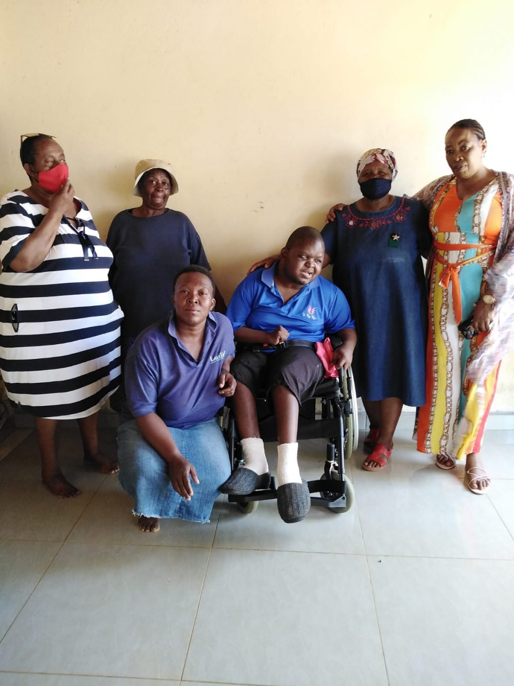 Disabled Edwin Mashaba, with family members. Pic by Thomo Nkgadima